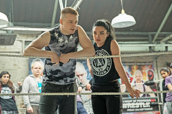 """DARE TO DREAM Saraya """"Paige"""" Bevis (Florence Pugh, right) comes from a wrestling family and earns a spot in the WWE, though her brother Zak (Jack Lowden) doesn't, in the biopic dramedy, Fighting with My Family. - PHOTO COURTESY OF METRO-GOLDWYN-MAYER"""