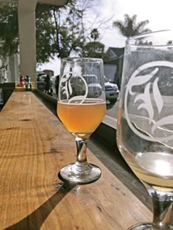 REWARD After a round-trip walk of the Bob Jones Trail, Karen Garcia and I enjoy beers at Libertine Brewing Company's Avila Beach tasting room. - PHOTOS BY PETER JOHNSON