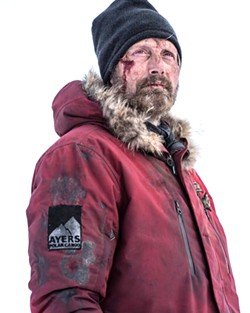 SURVIVOR Mads Mikkelsen stars as Overgård, a plane crash survivor who in turn must rescue a woman from a helicopter crash, in Arctic. - PHOTO COURTESY OF ARMORY PICTURES