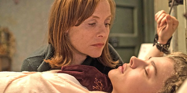 NOT WHAT SHE SEEMS Frances McCullen (Chloë Grace Moretz, right) finds a purse on the subway and returns it to Greta Hideg (Isabelle Huppert), who harbors ill intent for her new acquaintance, in Greta. - PHOTO COURTESY OF SIDNEY KIMMEL ENTERTAINMENT