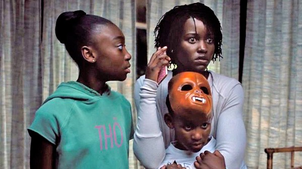 TERRORIZED A family—including mother Adelaide (Lupita Nyong'o right), daughter Zora (Shahadi Wright Joseph, left), and son Jason (Evan Alex, bottom right)—is threatened by evil doppelgängers, in Us. - PHOTO COURTESY OF MONKEYPAW PRODUCTIONS