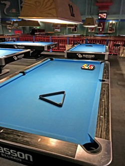 NOT-SO-HOT SHOT After going in the ocean, I walked over to one of my favorite pool halls, Hot Shots, to hone my mediocre pool game and watch March Madness—another spring favorite of mine. - PHOTOS BY PETER JOHNSON