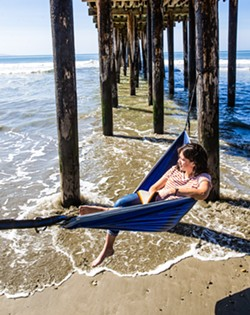 HANGING OUT One of New Times Staff Writer Karen Garcia's favorite things to do when the sun comes out is to put her hammock up in a peaceful spot and relax. - PHOTO BY JAYSON MELLOM