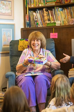 ALL YOU CAN READ Liz Krieger and her band of volunteers host a book party every spring where an elementary school class can come and take as many books as they can carry home with them. - PHOTOS BY JAYSON MELLOM