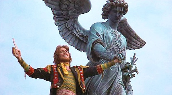 """CENTRAL PERK John the Baptist (David Haskell) cheerfully performs """"Prepare Ye"""" in Central Park in the 1973 musical, Godspell. - PHOTO COURTESY OF COLUMBIA PICTURES"""