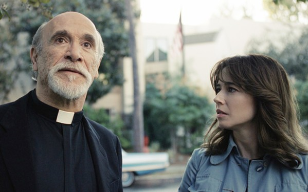 CURSED When an evil entity threatens her children, Anna Tate-Garcia (Linda Cardellini, right) turns to Father Perez (Tony Amendola) for help, in The Curse of La Llorona. - PHOTO COURTESY OF NEW LINE CINEMA