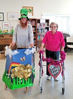 GETTING CRAFTY (from left to right) Central Coast Senior Center board member Sandy Stuart and charter member Pearl Cole display their customized walkers. - PHOTO COURTESY OF LONI KUENTZEL