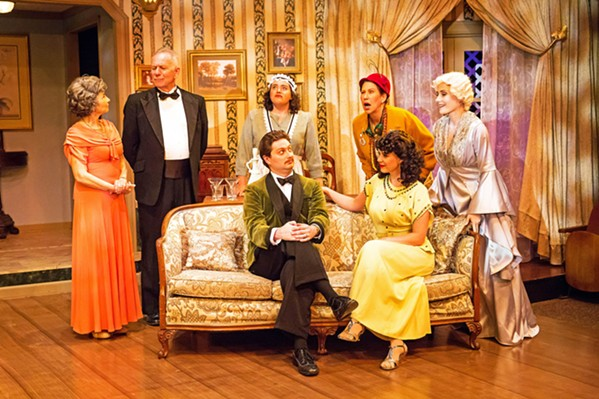 HAUNTED When a night of fun goes awry, the dead and the living must duke it out in Noël Coward's comic play, Blithe Spirit. From left to right: Mrs. Violet Bradman (Rosh Wright), Dr. George Bradman (Gary Paul-Clark), Edith (Kerry DiMaggio), Charles Condomine (Toby Tropper), Ruth Condomine (Rachel Tietz), Madame Arcati (Suzy Newman), and Elvira Condomine (Katie Worley-Beck). - PHOTOS COURTESY OF RYLO MEDIA DESIGN
