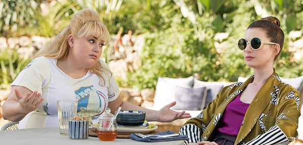 DESPERATELY UNFUNNY Mismatched female scam artists—low-rent Lonnie (Rebel Wilson, left) and classy Josephine (Anne Hathaway)—star in The Hustle, a lackluster remake of Dirty Rotten Scoundrels. - PHOTO COURTESY OF METRO-GOLDWYN-MAYER