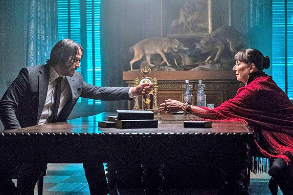 BLOOD PACT Wick (Keanu Reeves, left) demands safe passage for turning in his marker to The Director (Angelica Huston), who in doing so risks retaliation from the High Table, leaders of an assassins' guild. - PHOTOS COURTESY OF SUMMIT ENTERTAINMENT