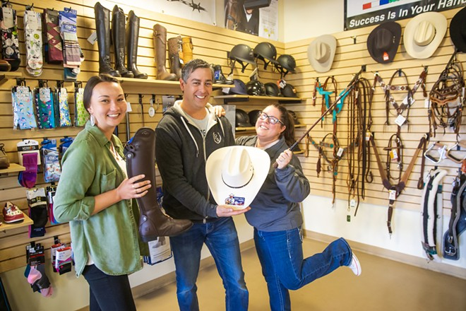 GETTIN' HORSEY WITH IT Need some tack? The Riding Warehouse in SLO has got your back—and so do Alisha Goto, Tony Camacho, and Christine Dietrich (left to right). - PHOTO BY JAYSON MELLOM