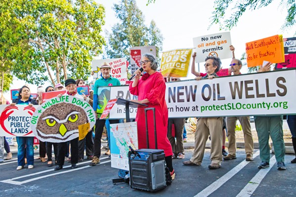 RESISTANCE SLO Mayor Heidi Harmon (center) leads a rally on May 22 against a federal plan to increase oil and gas production on public lands in Central California. - PHOTO BY JAYSON MELLOM
