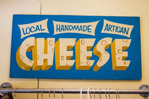 ALL YOU NEED TO KNOW Stepladder Creamery's cheese tasting room has more than just the cheese that's made on the other side of the wall. You can purchase honey, avocados, pork, and more. All of it, of course, is local. - PHOTO BY JAYSON MELLOM