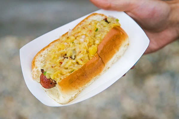 BACON WRAPPED BLISS The Hawaiian Dog is the most popular choice at Nick Regalia's street food outfit, Zen Dog. It includes a bacon-wrapped dog, with a tequila pineapple relish on a brioche bun. - PHOTO BY JAYSON MELLOM