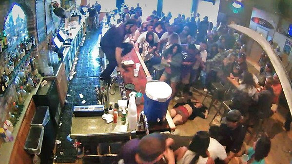 UNDER REVIEW SLO city building inspector Chris Olcott remains on paid leave two months after published video footage showed his assault on a man and woman in an Avila Beach bar (pictured). - SCREENSHOT COURTESY OF YOUTUBE