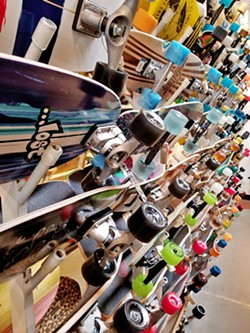 SHREDDIN' On 41st Avenue, walking into the Santa Cruz Boardroom is a must. Its back section is lined with unique and colorful skateboards. - PHOTOS BY KAREN GARCIA