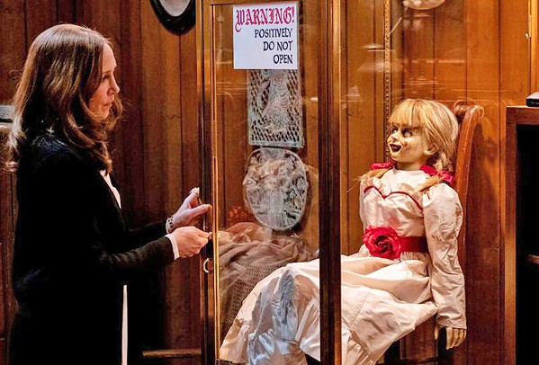 BREAK GLASS FOR SCARES! Demonologist Lorraine Warren (Vera Farmiga) thinks she's got possessed doll Annabelle locked safely away, but soon the doll is after her daughter, in Annabelle Comes Home. - PHOTO COURTESY OF NEW LINE CINEMA
