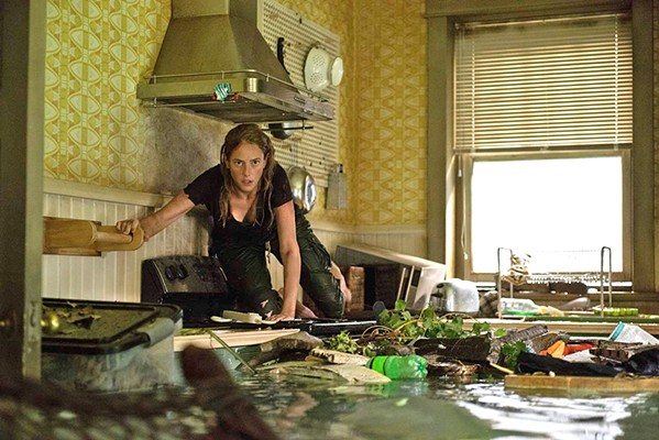 TEETH Haley Keller (Kaya Scodelario) returns home to save her father during a hurricane but discovers the flooding house is infested with alligators, in Crawl. - PHOTO COURTESY OF PARAMOUNT PICTURES