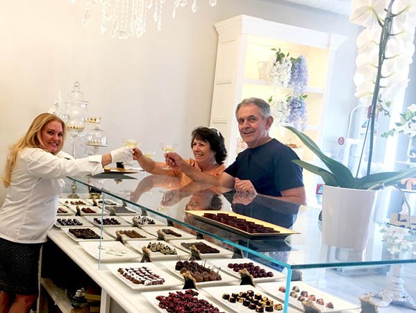 LIVING IT UP Locals Andrea and Randy Chavez decide to stop by Sheila Kearns Chocolate & Confections after a downtown matinee, on their way to the bookstore. Andrea is a big fan of Sheila's Cabernet Sea Salt Caramels, and Randy likes to try all the gluten-free bites. - PHOTO BY BETH GIUFFRE