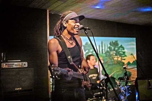 "SON OF SHIVAL BoomBala, featuring Balaram Redwine, son of local reggae icon Al ""Shival"" Redwine, plays the Arroyo Grande Village Summer Concert Series on July 28. - PHOTO COURTESY OF BOOMBALA"