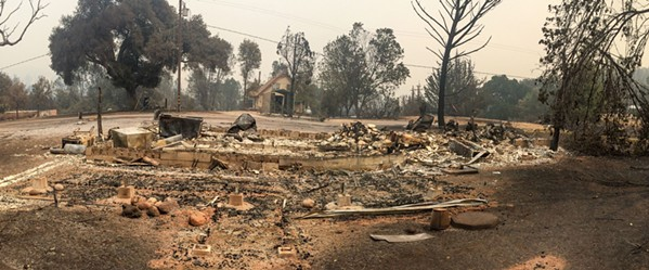 SCORCHED A Lake Nacimiento home is destroyed by the 2016 Chimney Fire in San Luis Obispo. - FILE PHOTO BY JAYSON MELLOM