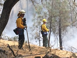 FIRE FIGHTS Firefighters work to put out the 2016 Chimney Fire in northern San Luis Obispo County. Catastrophic fire seasons in 2018 and 2019 triggered a slew of new state laws to address fire prevention, safety, and liability. - FILE PHOTO BY JAYSON MELLOM