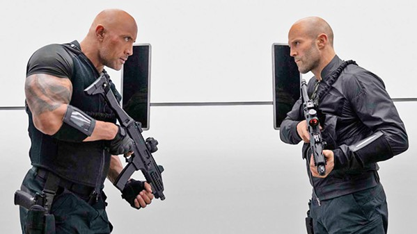 TEAM WORK Lawman Luke Hobbs (Dwayne Johnson, left) teams up with outcast Deckard Shaw (Jason Statham) to stop a genetically enhanced villain, in Fast & Furious Presents: Hobbs & Shaw. - PHOTO COURTESY OF UNIVERSAL PICTURES