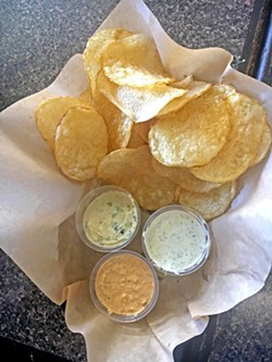 TUGBOAT TASTE TEST Which dip floats your boat? We tried the vegan garlic herb, brownie batter (which isn't pictured because we ate it too fast), jalapeño popper, and ranch. Chips are, without a doubt, America's favorite savory food vice, and I'm all in. - PHOTOS BY BETH GIUFFRE