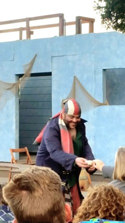 THANKS, MATEY! Before the Shakespeare Festival's Treasure Island begins, a swarthy pirate wanders the audience looking for loot. - PHOTOS BY ANDREA ROOKS