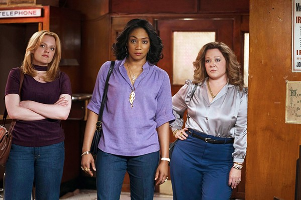 WOMEN IN CHARGE In 1970s New York, three gangsters' wives—(left to right) Claire (Elizabeth Moss), Ruby (Tiffany Haddish), and Kathy (Melissa McCarthy)—decide to continue running their husbands' Hell's Kitchen rackets after the men are imprisoned. - PHOTOS COURTESY OF BRON STUDIOS