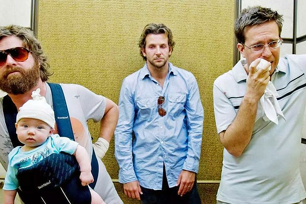WOLFPACK Alan (Zach Galifianakis), Phil (Bradley Cooper), and Stu (Ed Helms), left to right, have to piece together what happened during a wild night of bachelor partying in Vegas, in The Hangover. - PHOTO COURTESY OF NETFLIX