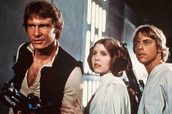 HEROES (Left to right) Han Solo (Harrison Ford), Princess Leia Organa (Carrie Fisher), and Luke Skywalker (Mark Hamill) team up to save the universe, in Star Wars: Episode IV—A New Hope, screening Aug. 24, in the Clark Center. - PHOTO COURTESY OF LUCASFILM