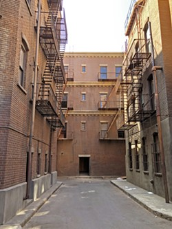 DOES WHATEVER A SPIDER CAN! This alleyway on the Warner Bros. lot is where Mary Jane Watson kissed an upside down Spider-Man, in Spider-Man (2002). - PHOTOS BY GLEN STARKEY