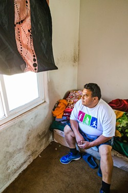INDUCING FEAR Grand View Apartments tenant Francisco Ramirez said he and the other residents were shaken by the termination notices from the owners because they don't know where to go. - FILE PHOTO BY JAYSON MELLOM