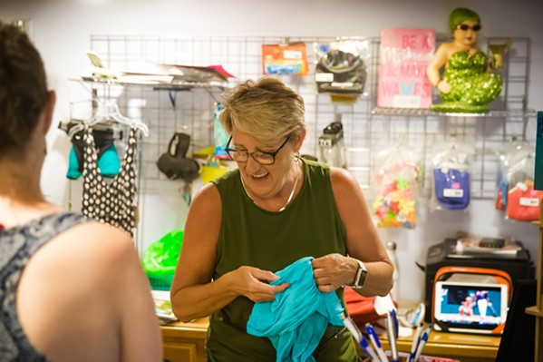 SURVIVING AND THRIVING Shelley Filip opened her swimsuit store, SLO Swim, in 1998. Despite years of changes and constant turnover, the business is still thriving in downtown SLO today. - PHOTO BY JAYSON MELLOM