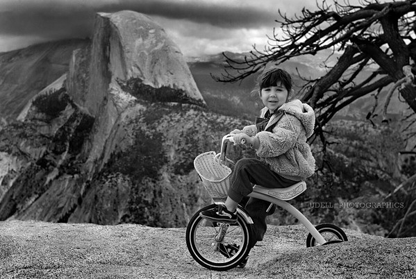 JOURNEY THROUGH TIME This photo of photographer Steve Udell's daughter, shot in 1984 at Glacier Point, is part of the People and Places exhibit. The original film photo did not develop properly, but Udell was able to save it with modern technology. - PHOTO COURTESY OF STEVE UDELL