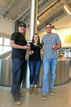 ROOTED IN WINE It makes sense that Firestone Walker Brewery got back to its roots in wine. Their very first beers were fermented in wine barrels. Pictured (from left to right) are Head Brewer Dustin Kral, Quality Control Manager Amy Crook, and Production Director Ali Razi. - PHOTO BY BETH GIUFFRE