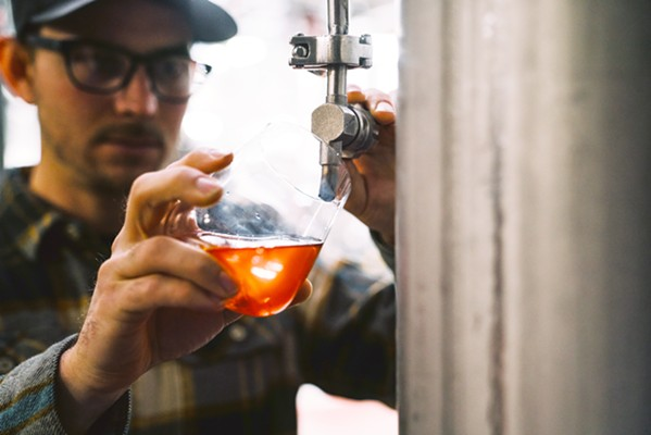 INDY WINE Firestone Walker Brewmaster Matt Brynildson's idea was to use subtle souring techniques to create an acid profile similar to rosé wine, co-fermenting light pilsner/white wheat malts and traditional hops wort with the wine grape juice to make beer and wine simultaneously. During the whirlpool phase, Brynildson and his team incorporated a generous dose of hibiscus flowers for rose petal aromas and a touch of natural citric acid. - PHOTO COURTESY OF FIRESTONE WALKER