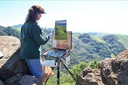 ART IN ACTION Sheryl Knight paints a mountainous scene en plein air. - PHOTO COURTESY OF SHERYL KNIGHT