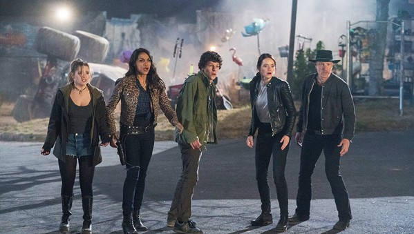 TEAM WORK (Left to right) Little Rock (Abigail Breslin), Nevada (Rosario Dawson), Columbus (Jesse Eisenberg), Wichita (Emma Stone), and Tallahassee (Woody Harrelson) face off against a zombie horde. - PHOTOS COURTESY OF COLUMBIA PICTURES