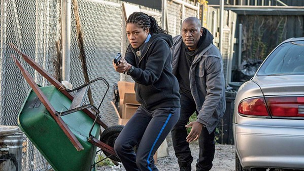 IN OVER HER HEAD Rookie cop Alicia West (Naomie Harris), with the help of Milo 'Mouse' Jackson (Tyrese Gibson), must navigate a dangerous world filled with criminals and corrupt cops, in Black and Blue. - PHOTO COURTESY OF SONY PICTURES