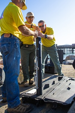 SONAR SLO Sheriff's dive team members assemble a side-scan sonar device to use in a training at Port San Luis on Oct. 12. - PHOTO BY JAYSON MELLOM