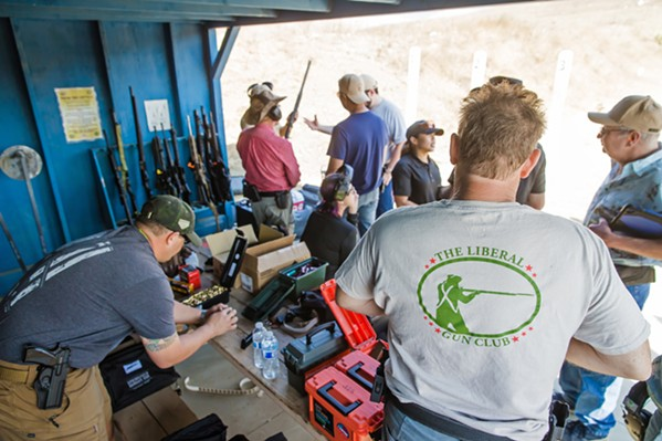 PREPPING FOR CLASS Lever-action rifle class attendees load up their guns with ammunition before the lesson starts on Oct. 26. - PHOTO BY JAYSON MELLOM