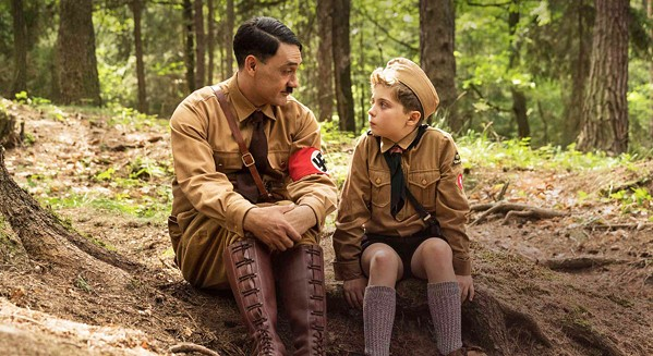 "MENTOR? Imaginary friend, ""Adolf"" (writer-director Tailka Waititi), counsels Jojo (Roman Griffin Davis), a Nazi-in-training who's worried that his mother is hiding a Jew, in the satire Jojo Rabbit. - PHOTO COURTESY OF PIKI FILMS"