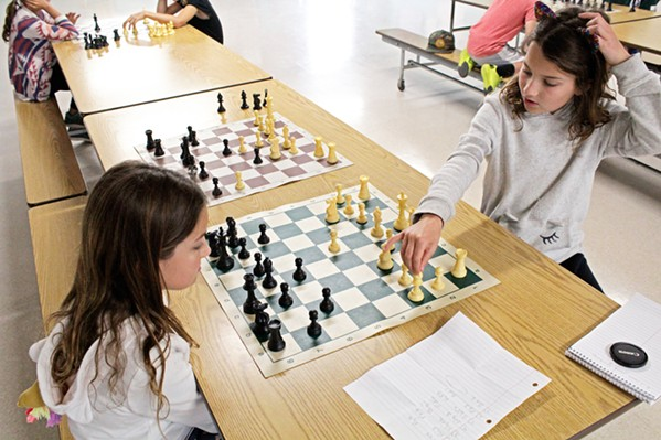 SISTER SISTER Twin sisters and ferocious competitors Cameron (left) and Avery (right) Connell play an evenly matched round of chess after class at Shell Beach Elementary School on Nov. 6. - PHOTO BY KASEY BUBNASH