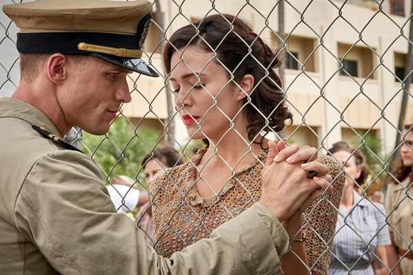 "CASUALTIES OF WAR Lt. Richard ""Dick"" Best (Ed Skrein) and his wife, Anne (Mandy Moore), share a quiet moment before Dick engages in the World War II-era Battle of Midway, which turned the tide in the Pacific Theater, in Midway. - PHOTO COURTESY OF AGC STUDIOS"