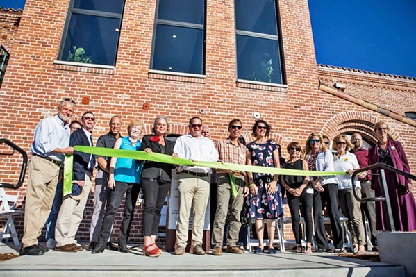 RIBBON CUTTING Local elected officials and nonprofit leaders attend the grand opening of the Bishop Street Studios on Nov. 16. The apartment complex will permanently house locals who are low income and living with mental illness. - PHOTO COURTESY OF THE CITY OF SAN LUIS OBISPO