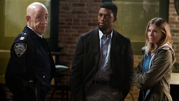 LAW AND ORDER? Chadwick Boseman (center) stars as NYPD Detective Andre Davis, surrounded by Capt. McKenna (J.K. Simmons, left) and Frankie Burns (Sienna Miller), in the so-so action crime drama 21 Bridges. - PHOTO COURTESY OF HUAYI BROTHERS