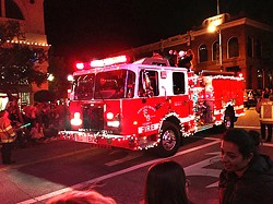 SPREADING CHEER On top of working most holidays, SLO County firefighters typically decorate their engines and ride in the annual Christmas parade. - PHOTO COURTESY OF SLO COUNTY FIRE DEPARTMENT
