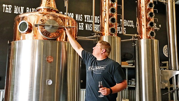 "MAKING LOVE One of the highlights of the movie was hearing Patrick Brooks, co-owner of Wine Shine, talk in his deep, friendly voice about making sexy brandies. He said it flows out of that still as ""pure brandy love."" - PHOTO COURTESY OF TIN CITY"